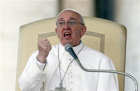 Pope Francis gestures as he speaks during a weekly general audience in Saint Peter's Basilica, at the Vatican