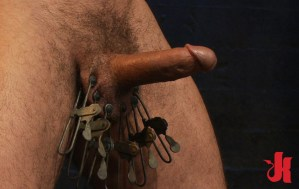 Kinky gay slave gets his balls covered in clamps by his dominating partner