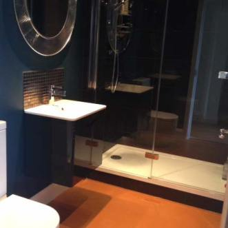 Bathroom with orange vinyl floor