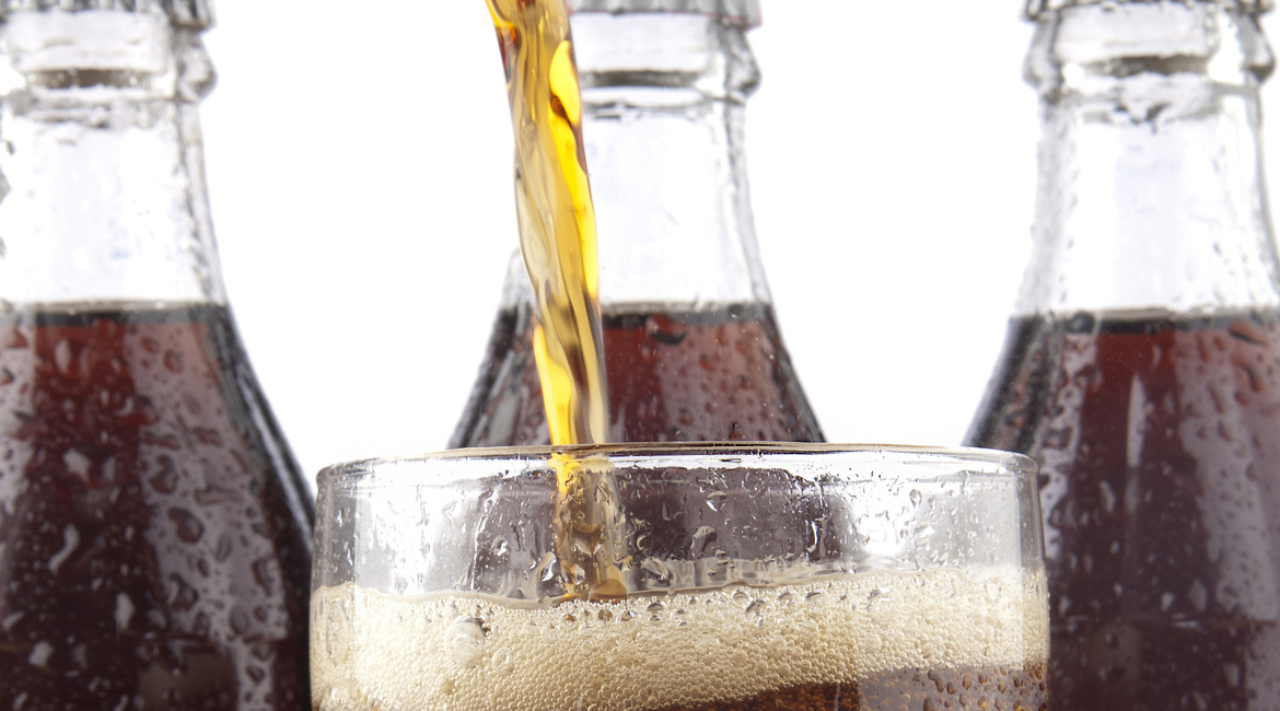 Pouring Cola isolated on white background