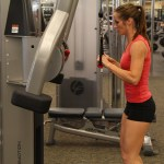 Bethany doing standing cable triceps pushdown option 2 at LA Fitness 1