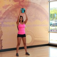 Cynthia-performing-medicine-ball-squat-to-throw-at-LA-Fitness-3