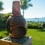 This unique, individually handcrafted chimenea from Bella Fuego Pottery is made with a special blend of stoneware clay. Not only does it radiate heat but it also acts as an interesting focal point in the garden.