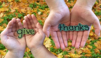 hands holding words give thanks