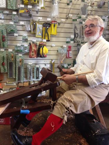 Glenn demonstrating traditional woodworking tools.