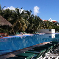A pool at the El Dorado Royale Resort