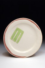 Plate with M, earthenware, slip, terra sig, glaze; 12in diameter, 2012