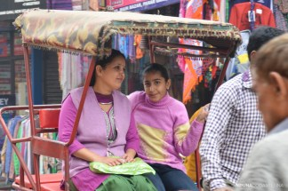 Indian mother and daughter having a Rickshow ride
