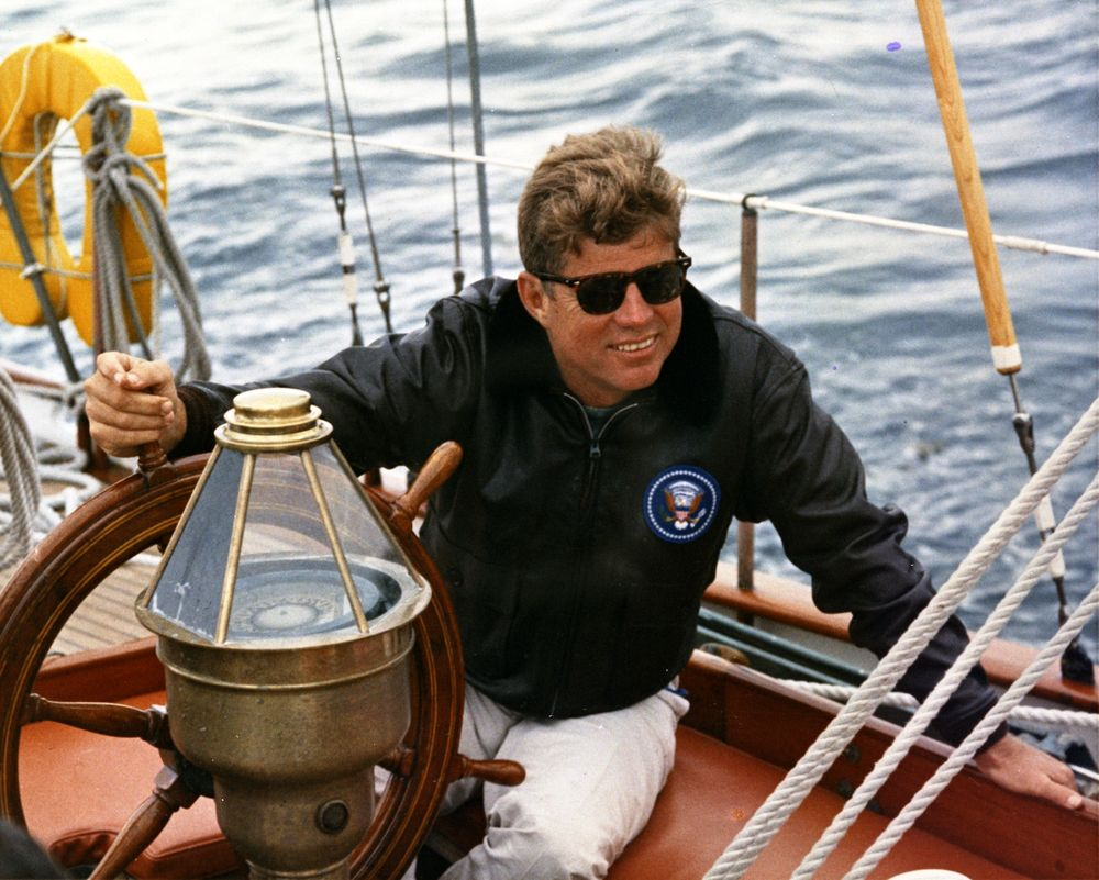 john kennedy wearing sunglasses sailing