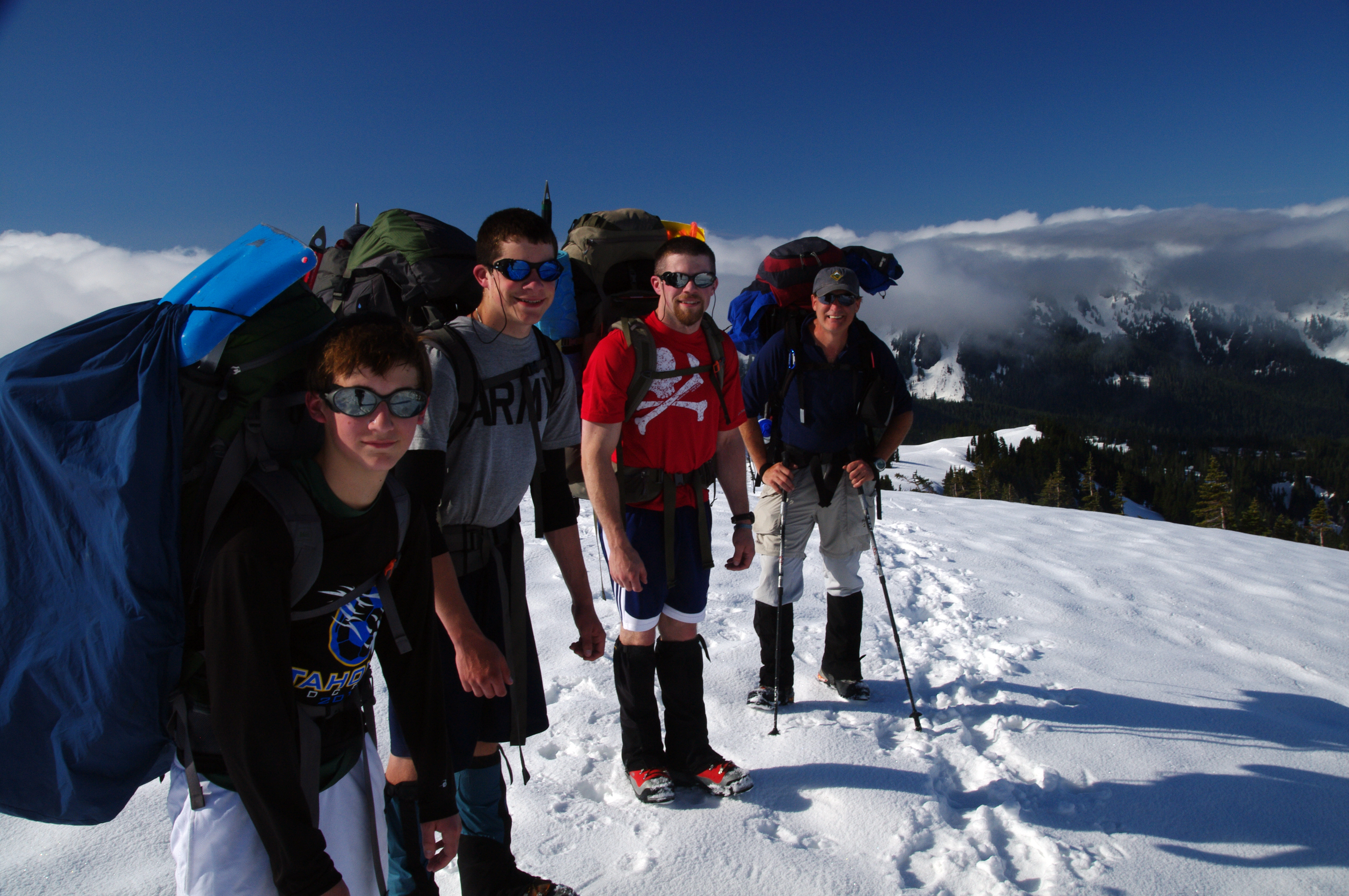 Climbers Daniel, Ryan, Reece, and John (from left) before they roped up and crossed the Nisquali Glacier with Scout Master Kent Brooten, designated photographer and Rainier veteran.