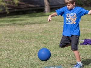 Cub-Scout-kicking-kickball