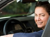 woman-driving-and-listening-to-ScoutCast