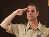 Cub Scout leader saluting