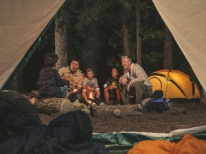 adult-leaders-around-campfire