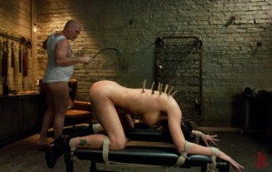 Bound brunette gets flogged while being tied up and covered in clothes' pins