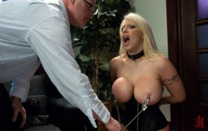 Submissive blonde in a corset gets her nipples clamped and have them pulled in nasty bdsm sex