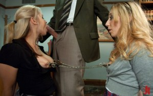 Two blonde sluts share a set of nipple clamps while one of them sucks off the principle in bdsm fuck