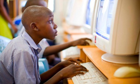 Student in Kenya using computer _blog.swaliafrica.com_