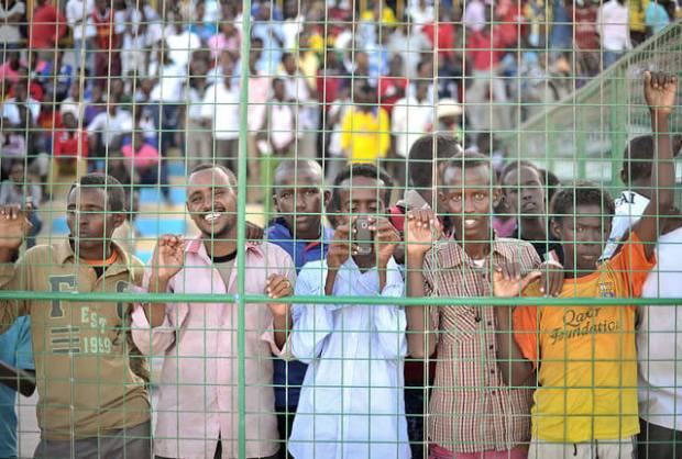 Young men watch a football match in Mogadishu, Somalia.