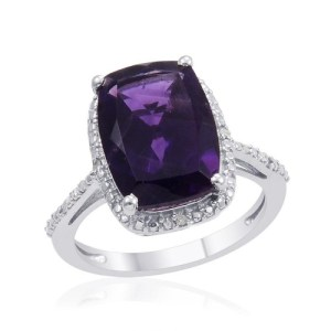 The singer stunned in bright purple and diamonds