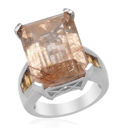 If funky and trendy is what you are after, this rutilated quartz and citrine ring is for you