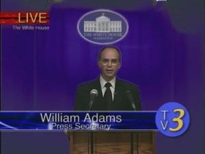 Scott Forbes as Press Secretary Adams
