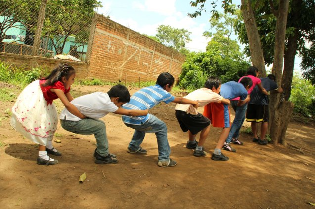 Sponsored children in El Salvador playing a game of Arranca Cebolla