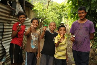 CFCA sponsored children in El Salvador play with their Capirucho toy