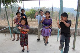 Sponsored children on swings