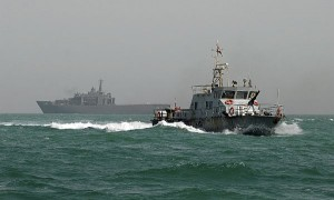 An Iraqi coastal patrol boat assigned to Combined Task Force (CTF) 158 patrols the Persian Gulf waters near the Al Basra Oil Terminal (ABOT) as the Republic of Singapore transport dock ship RSS Resolution (LST 208) (background) is underway off the coast of Iraq. CTF-158 is responsible for ensuring the security of Iraq's ABOT and the Khawr Al Amaya Oil Terminal (KAAOT) in support of U.N. Security Council Resolution 1790. (U.S. Navy photo/Released)