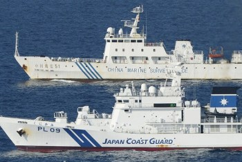 Associated Press Ships of China Marine Surveillance and Japan Coast Guard steam side by side near disputed islands, called Senkaku in Japan and Diaoyu in China, in the East China Sea on Oct. 25.