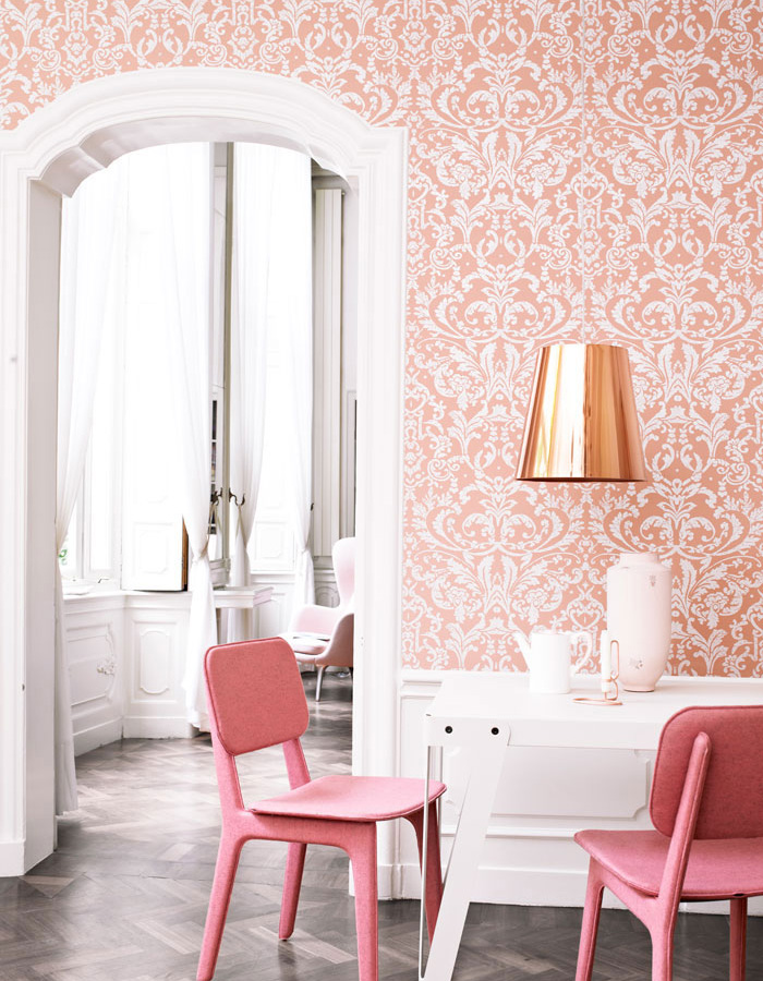 Another way to integrate wallpaper into smaller living rooms is by breaking up the walls with crown moulding and baseboards. You can even locate  your large scale floral into a smaller framed niche in your wall. It doesn't need to be a full wall, large details can be rich and subtle too.