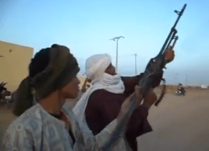 A still from a video showing people shooting in Northern Mali.