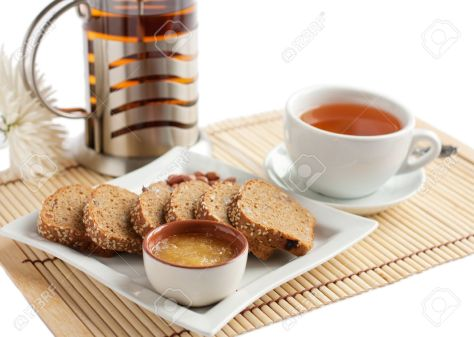 12714201-A-light-snack-of-tea-and-corn-bread-with-honey-and-nuts-white-ware-Isolated-on-white-Stock-Photo