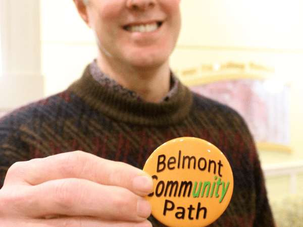 A Belmont Community Path supporter shows off his swag. A meeting next week will update the community on a survey of possible Community Path routes and solicit input.