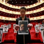 Photographs of guests who will attend the BAFTA awards ceremony are placed on seats at the Royal Opera House in London