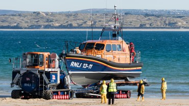 St Ives lifeboat coming ashore on a transporter