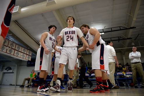 Akron's Brady Baer (24) on his way to the court during team introductions for their game against Caliche Feb. 13, 2014 in Akron.