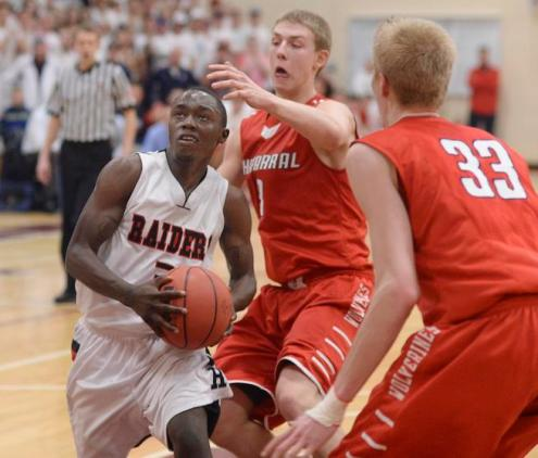 Raiders senior guard Trey Bridges (3) muscled his way through traffic in the first overtime period. The Rangeview High School boy's basketball team defeated Chaparral 88-85 in the second overtime period Wednesday night, March 5, 2014. (Karl Gehring, The Denver Post)