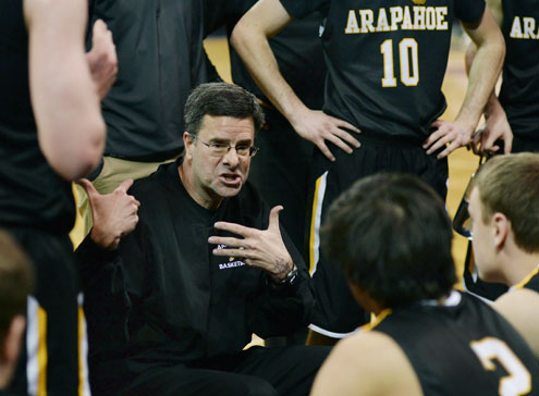 Arapahoe coach Dan Snyder talked it over with the team during a time out in the first half. The Fossil Ridge High School boy's basketball team faced Arapahoe Friday night, March 7, 2014 in Denver. (Karl Gehring, The Denver Post)