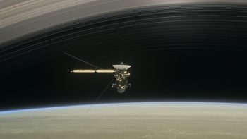 Ring Crossing: In this still from the short film Cassini's Grand Finale (https://saturn.jpl.nasa.gov/resources/7628/), the spacecraft is shown diving between Saturn and the planet's innermost ring. Credit: NASA/JPL-Caltech