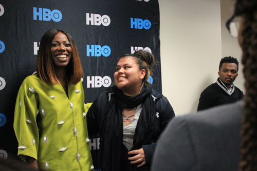 A fan meets Yvonne Orji, the one of the stars of HBO's Insecure, at a screening hosted by the Black Student Union. Anne McBride | Hatchet Staff Photographer