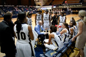 Head coach Jonathan Tsipis talks strategy with his team during a timeout last season. Hatchet File Photo