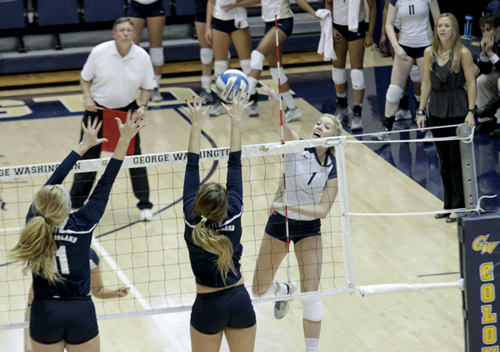 Senior outside hitter Rachael Goss spikes the ball during Sunday's match against Rhode Island. GW lost in four sets, bringing an end to the team's four-game winning streak. Cameron Lancaster | Contributing Photo Editor