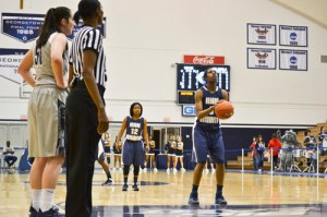 Freshman Caira Washington, who may have an easier matchup this week against Loyola, shoots a free throw at Georgetown earlier this season. Alexandra Kruse | Hatchet Photographer