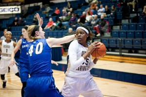 Sophomore Jonquel Jones fights off a defender earlier this season. Hatchet File Photo