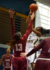 Freshman Caira Washington goes up for a shot earlier this season. She earned her third A-10 Rookie of the Week Award Monday. Hatchet File Photo
