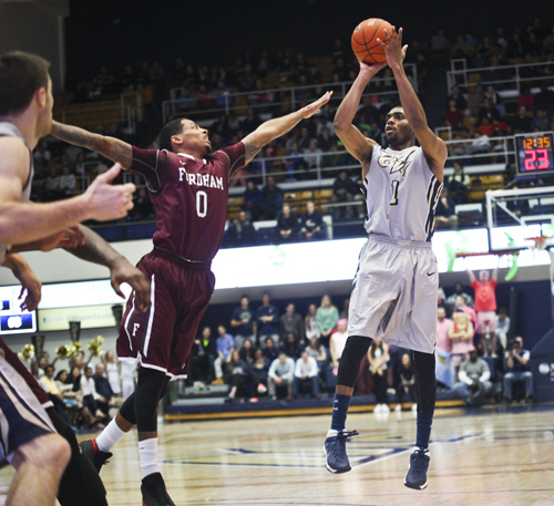 Guard Maurice Creek hits a jumper against Fordham on Saturday. Creek led GW with 20 points. Cameron Lancaster | Assistant Photo Editor