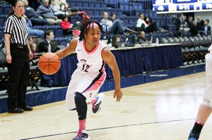 Graduate Student Danni Jackson dribbles in a win earlier this season. Hatchet File Photo