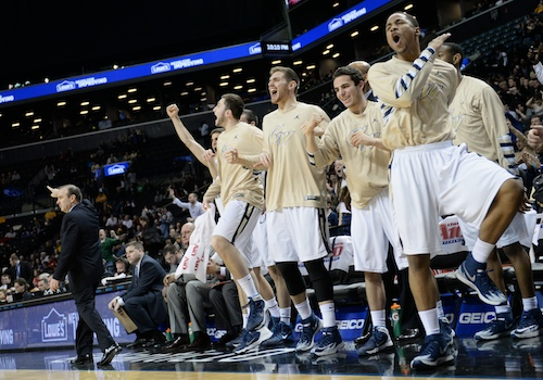 GW's bench erupts during the Colonials' red-hot second half, when they shot 51.7 percent from the field. Samuel Klein | Photo Editor